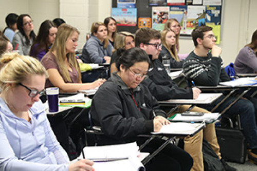 Students sitting in a class taking notes