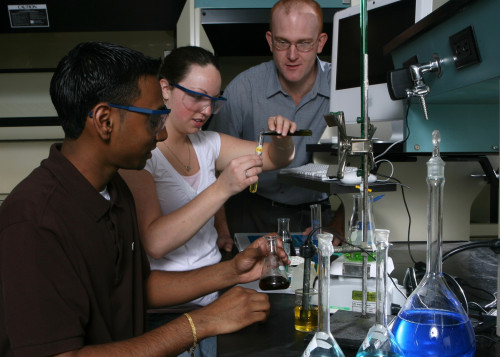 Students in a lab mixing liquids