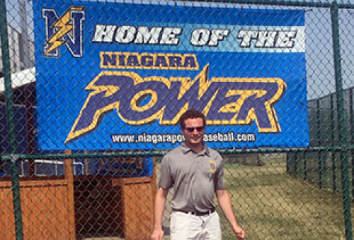 Male student in grey polo in front of Niagara Power sign