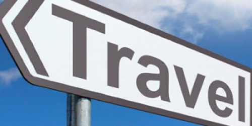 Picture of a sign that says Travel.