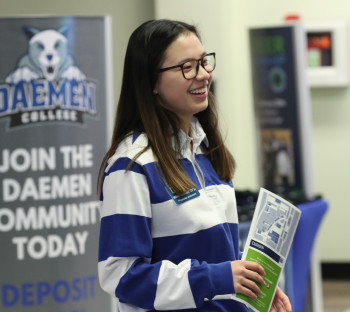 Female Student Scholar Ambassador welcoming people in Wick