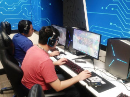 Jose Mejia and Justin Fang playing League of Legends in the esports room